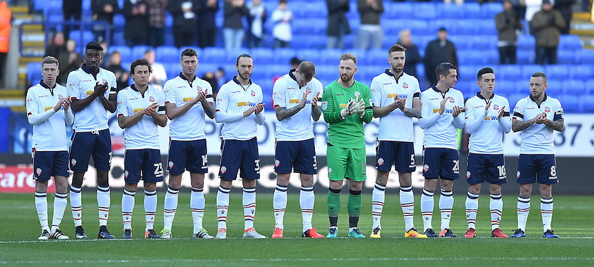 The Bolton players observe the minutes applause for the Brazilian disaster<br /> <br /> Photographer Dave Howarth/CameraSport<br /> <br /> The Emirates FA Cup Second Round - Bolton Wanderers v Sheffield United - Sunday 4th December 2016 - Macron Stadium - Bolton<br />  <br /> World Copyright &copy; 2016 CameraSport. All rights reserved. 43 Linden Ave. Countesthorpe. Leicester. England. LE8 5PG - Tel: +44 (0) 116 277 4147 - admin@camerasport.com - www.camerasport.com