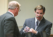 Defense witness John Nenna, right, is questioned by Prince William County (Virginia) commonwealth Attorney Paul S. Ebert during his testimony in the trial of sniper suspect John Allen Muhammad in the Virginia Beach Circuit Court in Virginia Beach, Virginia on November 12, 2003.  <br /> Credit: Lawrence Jackson - Pool via CNP