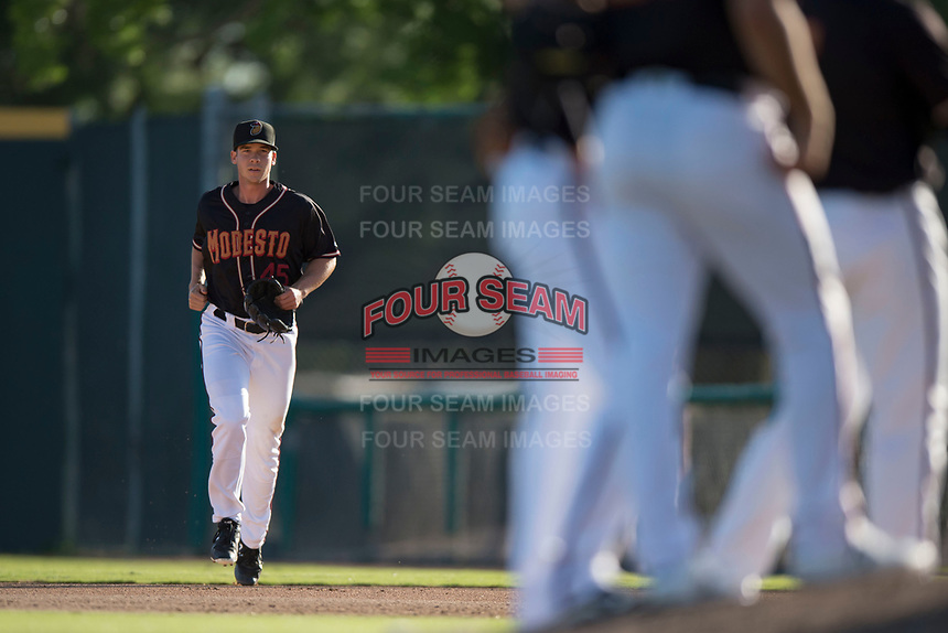 Modesto Nuts relief pitcher Colin Rodgers (45) jogs to the mound during a California League game against the San Jose Giants at John Thurman Field on May 9, 2018 in Modesto, California. San Jose defeated Modesto 9-5. (Zachary Lucy/Four Seam Images)