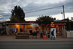 EL PORVENIR, BAJA CALIFORNIA - NOVEMBER 26, 2013:  A street scene in El Porvenir, one of the small towns populating Baja California's Valle de Guadalupe. Residents and wineries in Mexico's wine country are protesting the mayor's relaxing of zoning regulations they say will lead to a drastic change in the culture of  the popular tourist destination.  CREDIT: Max Whittaker for The New York Times