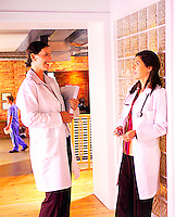 Female doctors standing and having a conversation