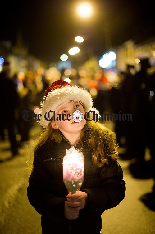 Local girl Lisa Greene taking part in the annual candlelit carol singing event at Miltown Malbay. Photograph by John Kelly.