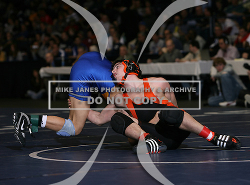 Antonio Doldo (III) and Kenny Betts (VI) square off in the NY State Division Two finals at the 145 weight class during the NY State Wrestling Championship finals at Blue Cross Arena on March 9, 2009 in Rochester, New York.  (Copyright Mike Janes Photography)