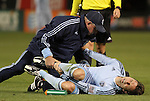 10 March 2012: Kansas City's Bobby Convey is attended to by trainer Chet North after suffering an ankle injury. Sporting Kansas City defeated DC United 1-0 at RFK Stadium in Washington, DC in a 2012 regular season Major League Soccer game.