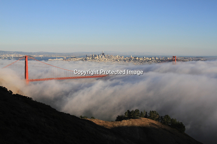 The autumn fog rolls through the Golden Gate Bridge underlining the San Francisco skyline.