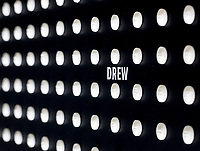 NWA Democrat-Gazette/DAVID GOTTSCHALK Individual names are visible Wednesday, October 3, 2018, on a wall, part of the Prescribed to Death: A Memorial to the Victims of the Opioid Crisis, constructed of 22,000 carved pills, each representing the face of someone who fatally overdosed on a prescribed opioid in 2015, inside the Arkansas Union on the campus in Fayetteville. The memorial also offers resources to help visitors both safely dispose of unused pills in their homes and facilitate discussions with prescribers about alternatives. The Associated Student Government is a supporting partner in the exhibit, reserving space on campus and providing volunteers during the week. The exhibit fits in to the ASG's ongoing effort to educate the campus about the danger of opioids. The exhibit is open to the public through Tuesday, October 9.