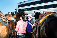 Miss Rodeo Colorado 2016 contestants Sara Coblentz, left, and Mandi Larson prepare their horses saddles during the Miss Rodeo Queen Colorado competition at the Greely Stampede in Greely, Colorado, July 1, 2015.<br /> <br /> Photo by Matt Nager