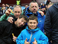 Swansea Fans arrive for the game braving the wet weather before the Barclays Premier League match between Aston Villa v Swansea City played at the Villa Park Stadium, Birmingham on October 24th 2015