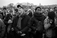 Donald Trump supporters, John Henson, far left, and Mike Wick, center left smile while Barack Obama supporter, Marvellous Guerrier, center right, remains somber at the National Mall during the Inauguration Day ceremony in Washington, DC on Inauguration Day, Jan. 20, 2017.