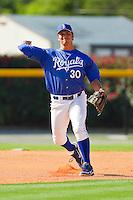 Burlington Royals third baseman Patrick Leonard #30 makes a throw to first base during practice at Burlington Athletic Park on June 15, 2012 in Burlington, North Carolina.  (Brian Westerholt/Four Seam Images)