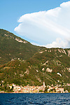 Varenna, Italy on Lake Como with lots of sunlight and a huge cloud above the mountains