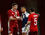 Liam Birdcutt of Scotland is caught up in a bust up with Andreas Christensen and Riza Durmisi of Denmark following a bad tackle during the Vauxhall International Challenge Match match at Hampden Park Stadium. Photo credit should read: Simon Bellis/Sportimage