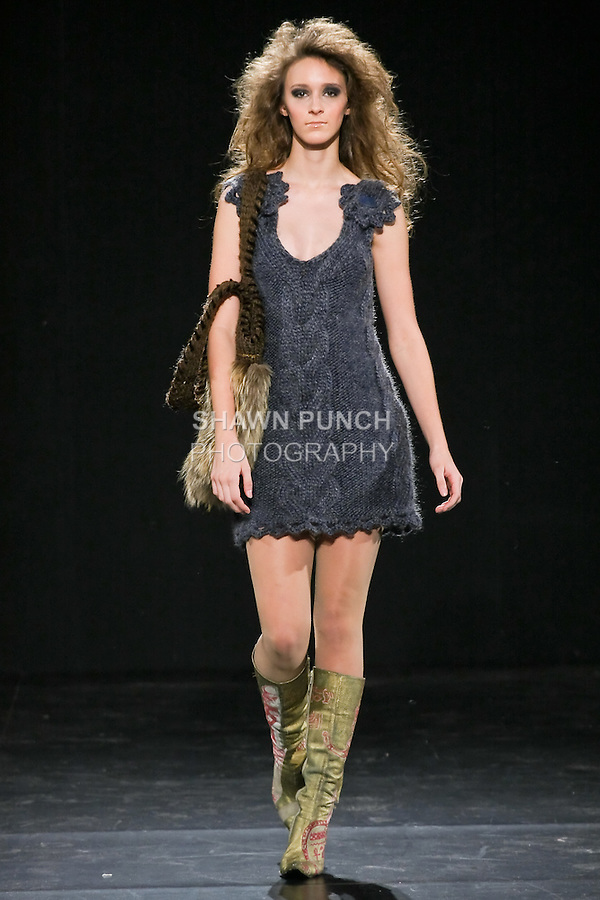 Model walks runway in a Janerations Fall 2011 couture knitwear outfit, by Janina Stankiene, during Couture Fashion Week 2011.