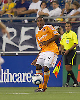 Houston Dynamo defender Jermaine Taylor (4) passes the ball. In a Major League Soccer (MLS) match, the New England Revolution tied Houston Dynamo, 1-1, at Gillette Stadium on August 17, 2011.