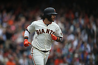 SAN FRANCISCO, CA - AUGUST 9:  Brandon Crawford #35 of the San Francisco Giants runs to first base against the Chicago Cubs during the game at AT&T Park on Wednesday, August 9, 2017 in San Francisco, California. (Photo by Brad Mangin)