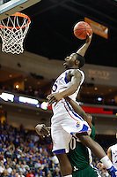 Nov. 26, 2010. Las Vegas, NV: The Kansas Jayhawks' Elijah Johnson is intentionally fouled by   Ricardo Johnson as he dunks in the Las Vegas Invitational at the Orleans Arena.