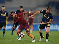 Calcio, Serie A: Roma vs Inter. Roma, stadio Olimpico, 2 ottobre 2016.<br /> Roma&rsquo;s Mohamed Salah, left, is chased by FC Inter&rsquo;s Davide Santon during the Italian Serie A football match between Roma and FC Inter at Rome's Olympic stadium, 2 October 2016.<br /> UPDATE IMAGES PRESS/Isabella Bonotto