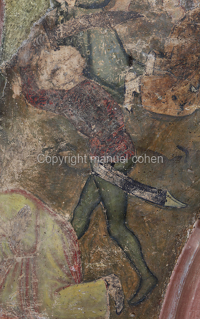 Roman soldier, detail of the fresco depicting the trial and martyrdom of St Foy in Agen in 303 AD, on the wall of the South transept, in the Abbatiale Sainte-Foy de Conques or Abbey-church of Saint-Foy, Conques, Aveyron, Midi-Pyrenees, France, a Romanesque abbey church begun 1050 under abbot Odolric to house the remains of St Foy, a 4th century female martyr. The church is on the pilgrimage route to Santiago da Compostela, and is listed as a historic monument and a UNESCO World Heritage Site. Picture by Manuel Cohen