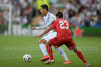 Cardiff City Stadium, Cardiff, South Wales - Tuesday 12th Aug 2014 - UEFA Super Cup Final - Real Madrid v Sevilla - <br /> <br /> Sevilla&rsquo;s Coke battles with Real Madrid&rsquo;s Christiano Ronaldo during the game. <br /> <br /> <br /> <br /> <br /> Photo by Jeff Thomas/Jeff Thomas Photography