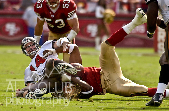 San Francisco 49ers defensive end Andre Carter (96) sacks Tampa Bay Buccaneers quarterback Brad Johnson (14) on Sunday, October 19, 2003, in San Francisco, California. The 49ers defeated the Buccaneers 24-7.