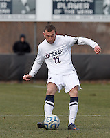 University of Connecticut defender Max Wasserman (22) passes the ball. .NCAA Tournament. With a goal in the second overtime, University of Connecticut (white) defeated University of New Mexico (red), 2-1, at Morrone Stadium at University of Connecticut on November 25, 2012.