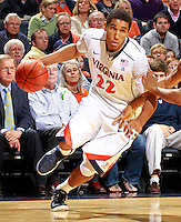 CHARLOTTESVILLE, VA- NOVEMBER 29: Malcolm Brogdon #22 of the Virginia Cavaliers handles the ball during the game on November 29, 2011 at the John Paul Jones Arena in Charlottesville, Virginia. Virginia defeated Michigan 70-58. (Photo by Andrew Shurtleff/Getty Images) *** Local Caption *** Malcolm Brogdon
