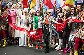 London, UK. Photocall and official start of the parade with the stars of Absolutely Fabulous Jennifer Saunders and Joanna Lumley (centre) as well as their lookalikes and flagbearers. 25 June 2016. The annual LGBT Pride London parade starts at Langham Place.
