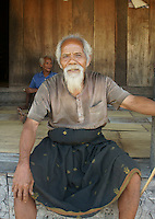 village elder Sakrias, he deeply enjoys traditional life in his village and is full of good humour. Village Bena, Ngada people, Flores, Indonesia