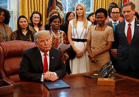 "United States President Donald J. Trump signs the National Security Presidential Memorandum to Launch the ""Women's Global Development and Prosperity"" Initiative in the Oval Office of the White House in Washington, DC on Thursday, February 7, 2019. Also pictured is First Daughter and Advisor to the President Ivanka Trump.<br /> Credit: Martin H. Simon / CNP/AdMedia"