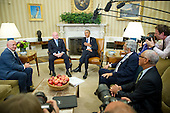 United States President Barack Obama meets retired NASA astronaut Scott Kelly and his brother Mark in the Oval Office of the White House in Washington, DC on Friday, October 21, 2016.  From left to right: Former NASA astronaut Mark Kelly; Scott Kelly; President Obama; John P. Holdren, Assistant to the President for Science and Technology, Director of the White House Office of Science and Technology Policy, and Co-Chair of the President's Council of Advisors on Science and Technology; and Major General Charles Bolden, Jr., (USMC-Retired), NASA Administrator.<br /> Credit: Ron Sachs / Pool via CNP