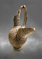 Phrygian terra cotta pottery vessel with a strainer and long pouring lip, decorated with geometric designs and images of animals and birds, from Gordion. Phrygian Collection, 9th century BC - Museum of Anatolian Civilisations Ankara. Turkey. Against a grey background