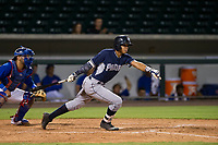 AZL Padres shortstop Kelvin Alarcon (3) follows through on his swing against the AZL Cubs on August 28, 2017 at Sloan Park in Mesa, Arizona. AZL Cubs defeated the AZL Padres 2 9-4. (Zachary Lucy/Four Seam Images)