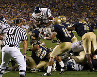 University of Connecticut running back Lou Allen hurdles University of Pittsburgh defenders to score on a one-yard touchdown run as the Huskies beat the Panthers 34-14 on September 22, 2007 at Heinz Field in Pittsburgh, Pennsylvania.
