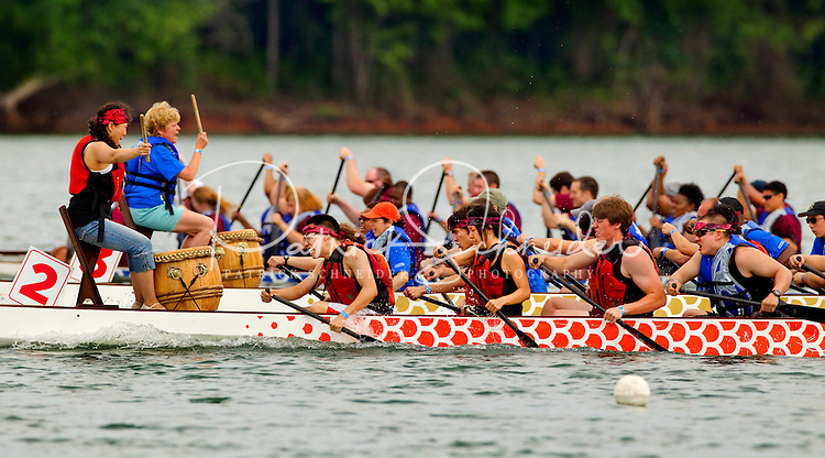 Event photography of the annual Charlotte Asian Festival and Dragon Boat Festival Race, held May 5, 2012 on Lake Norman. Dragon boat racing is an important Chinese tradition. The event originated more than 2,300 years ago on the rivers of southern China. The two festivals celebrate Asian cultures, diversity, ethnicity, roots and history. According to the Carolinas Asian-American Chamber of Commerce, fewer than 200 Asians and only eight Asian businesses were in Charlotte in the 1960s. Today, according to the Chamber, the Asian-American population in greater Charlotte has grown to around 70,000, representing more than 15 countries of origin, and hundreds of businesses.