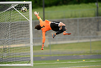 Osbourn goalkeeper Diego Villatoro leaps in vain as the game-winning goal soars just over his reach into the top right corner of the net. Battlefield defeated Osbourn 2-0 in the Cedar Run District Championship game 5-17-18 at Patriot H.S..