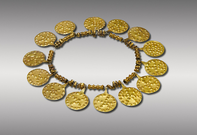 Bronze Age Hattian gold necklace from Grave E,  possibly a Bronze Age Royal grave (2500 BC to 2250 BC) - Alacahoyuk - Museum of Anatolian Civilisations, Ankara, Turkey. Against a gray background