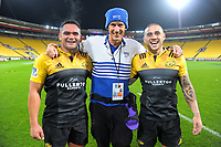 "Photographer Russell ""Chainsaw"" Potts with Norths players Leni Apisai (left) and TJ Perenara after the Super Rugby match between the Hurricanes and Stormers at Westpac Stadium in Wellington, New Zealand on Friday, 5 May 2017. Photo: Dave Lintott / lintottphoto.co.nz"
