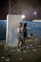 BENICÀSSIM, SPAIN - A festival goer checks her mobile phone during a set by German DJ Boys Noize at the Festival Internacional de Benicàssim...Described by some as a Mediterranean Glastonbury, the Festival Internacional de Benicàssim (FIB) is the largest music festival outside the UK to target British visitors. In 2010, seven of the eight main headline slots were filled by English bands...A small coastal town of 13,000 inhabitants, Benicàssim hosted some 200,000 visitors in 2009, with 40% of those believed to be coming from the UK. In 2010, attendances fell to 127,000 visitors but the percentage of UK visitors is believed to have risen.