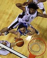 Saints guard Reece Cassidy tries to lay a shot up under pressure from Heat forward Ben Anthony during the National Basketball League match Wellington Saints and Harbour Heat at TSB Bank Arena, Wellington, New Zealand on Saturday 13 June 2009. Photo: Dave Lintott / lintottphoto.co.nz