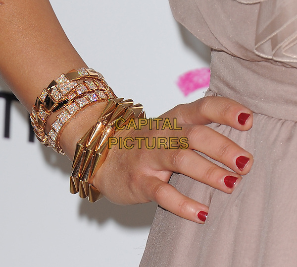 RASHIDA JONES' hand.19th Annual Elton John AIDS Foundation Academy Awards Viewing Party held at The Pacific Design Center, West Hollywood, California, USA..February 27th, 2011.on hip beige gold bracelets red nail varnish polish diamonds .CAP/RKE/DVS.©DVS/RockinExposures/Capital Pictures.