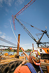 Erection of the tower crane during construction of Trimet's Portland-Milwaukie Light Rail Bridge.