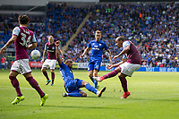 Gabriel Agbonlahor of Aston Villa shoots at goal under pressure from Loic Damour of Cardiff City during the Sky Bet Championship match between Cardiff City and Aston Villa at the Cardiff City Stadium, Cardiff, Wales on 12 August 2017. Photo by Mark  Hawkins / PRiME Media Images.