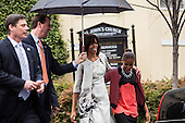 First Lady Michelle Obama walks with her daughter Sasha after the First Family attended an Easter church service at St John's Episcopal Church  in Washington, Sunday, March 31, 2013. .Credit: Drew Angerer / Pool via CNP