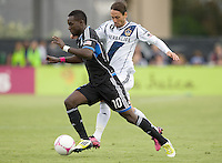 Simon Dawkins of Earthquakes dribbles the ball away from ]Marcelo Sarvas of Galaxy during the game at Buck Shaw Stadium in Santa Clara, California on October 21st, 2012.  San Jose Earthquakes and Los Angeles Galaxy tied at 2-2.