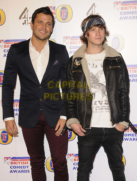 Mark Wright & Dougie Poynter.The British Comedy Awards 2011 at the Fountain Studio's, Wembley, London, England..16th December 2011.arrivals half length white shirt sheepskin aviator leather jacket red trousers t-shirt head scarf bandana jeans denim  .CAP/CAN.©Can Nguyen/Capital Pictures.