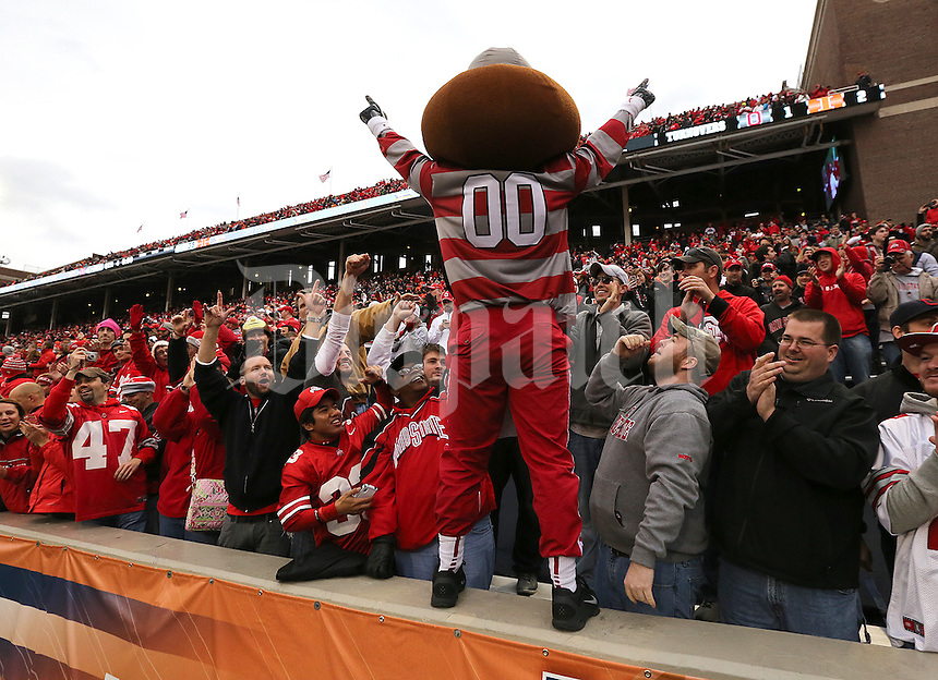 Brutus Buckeye celebrates the Ohio State University football win against the Fighting Illini following the end of their game at Memorial Stadium in Champaign, Ill on November 16, 2013. (Columbus Dispatch photo by Brooke LaValley)
