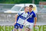 Castleisland Desmond's Pierce Cronin and St Mary's Daniel Daly in action in the division 3 clash at Castleisland on Saturday.