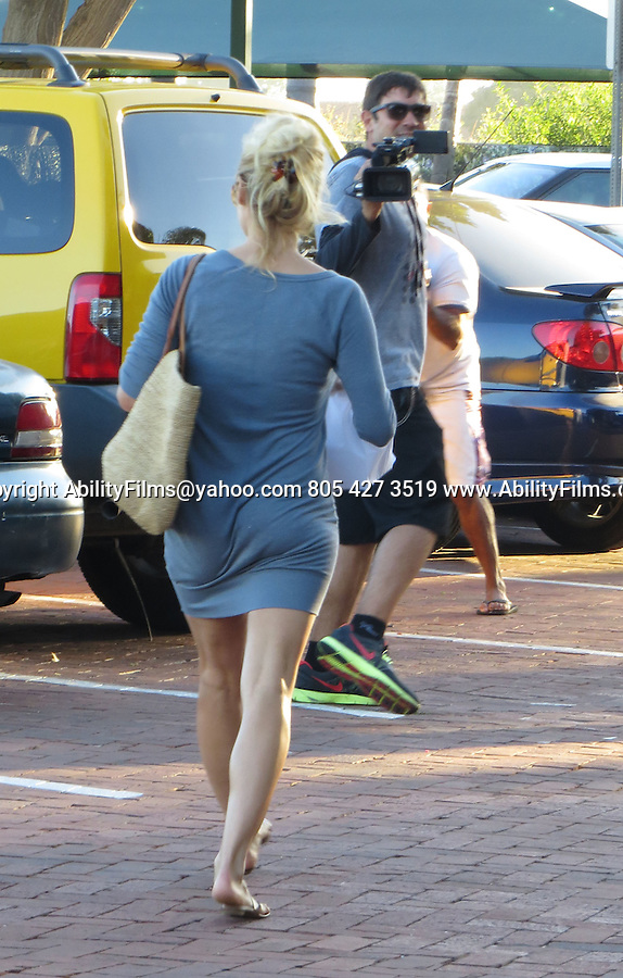 July 24th 2012  <br /> <br /> Pamela Anderson eating at Taverna Tony restaurant in Malibu California with two male friends. Pamela did  a little window shopping after lunch while wearing a tight gray short dress skirt showing off her legs. <br /> <br /> <br /> AbilityFilms@yahoo.com<br /> 805 427 3519<br /> www.AbilityFilms.com