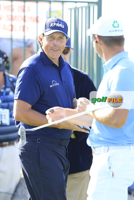 Phil Mickelson and Bryson DeChambeau (USA) on the 1st tee to start their match during Sunday's Final Round of the Waste Management Phoenix Open 2018 held on the TPC Scottsdale Stadium Course, Scottsdale, Arizona, USA. 4th February 2018.<br /> Picture: Eoin Clarke | Golffile<br /> <br /> <br /> All photos usage must carry mandatory copyright credit (&copy; Golffile | Eoin Clarke)