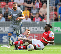 Rotherham United's Freddie Ladapo is tackled by Lincoln City's Michael O'Connor<br /> <br /> Photographer Chris Vaughan/CameraSport<br /> <br /> The EFL Sky Bet Championship - Rotherham United v Lincoln City - Saturday 10th August 2019 - New York Stadium - Rotherham<br /> <br /> World Copyright © 2019 CameraSport. All rights reserved. 43 Linden Ave. Countesthorpe. Leicester. England. LE8 5PG - Tel: +44 (0) 116 277 4147 - admin@camerasport.com - www.camerasport.com